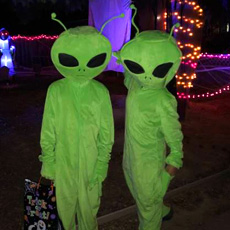 Two children dressed as aliens.